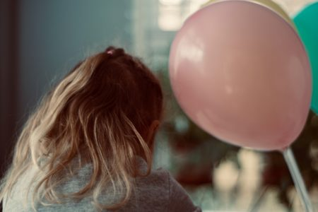 Girl with pink balloon.