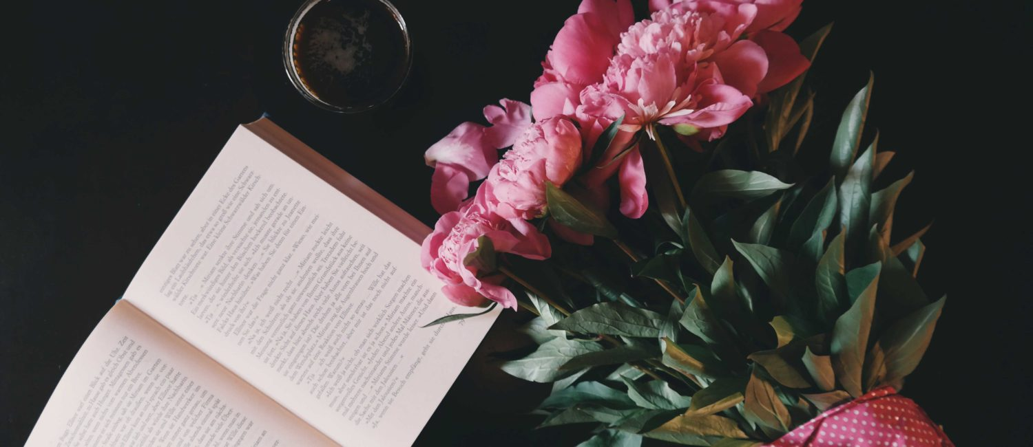 Peonies with open book.
