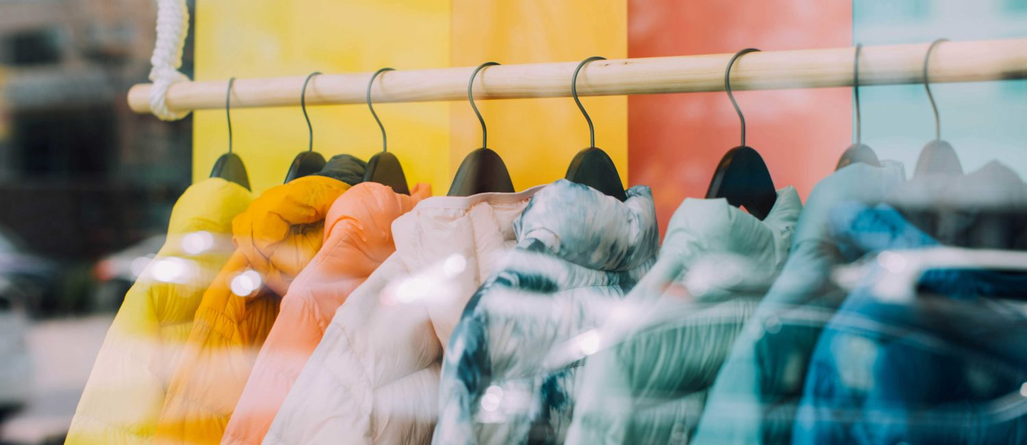 Colorful coats in window