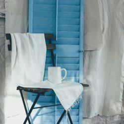 blue shutter with chair