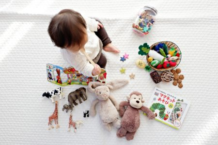 child with toys from above
