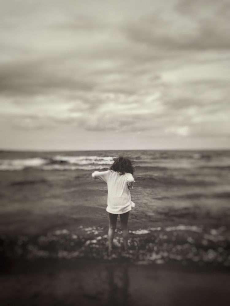 girl at shoreline