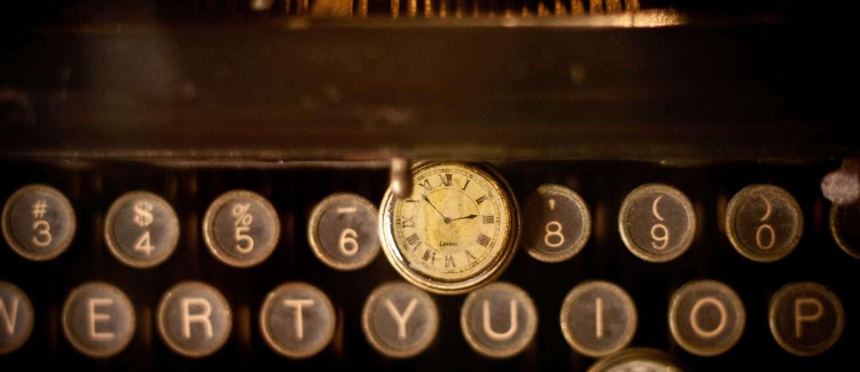 typewriter and antique watch
