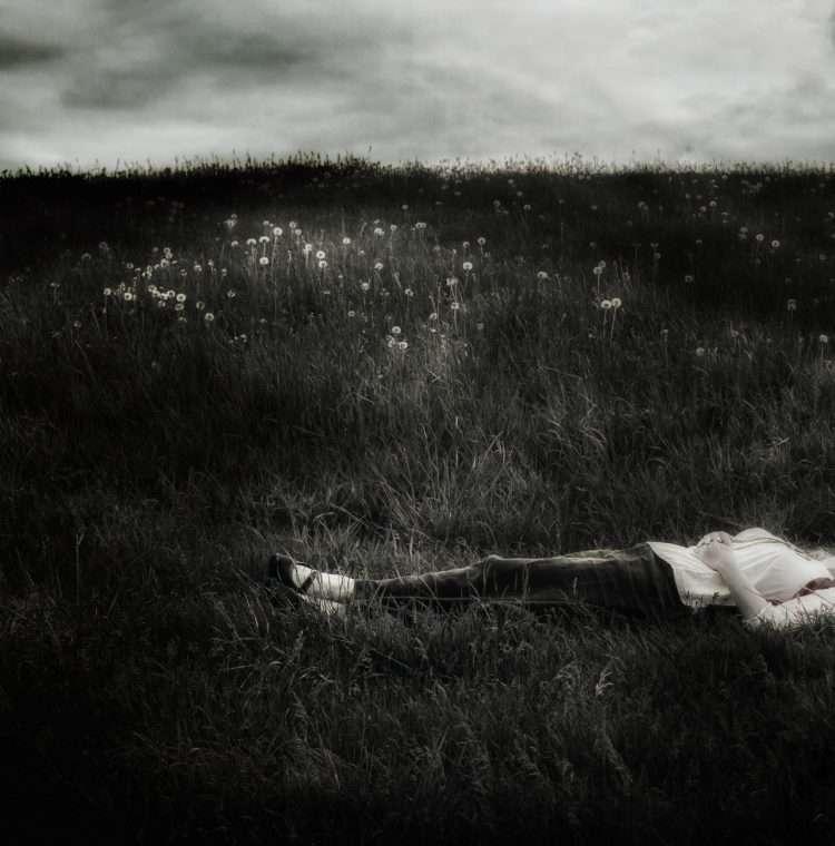 woman lying in field