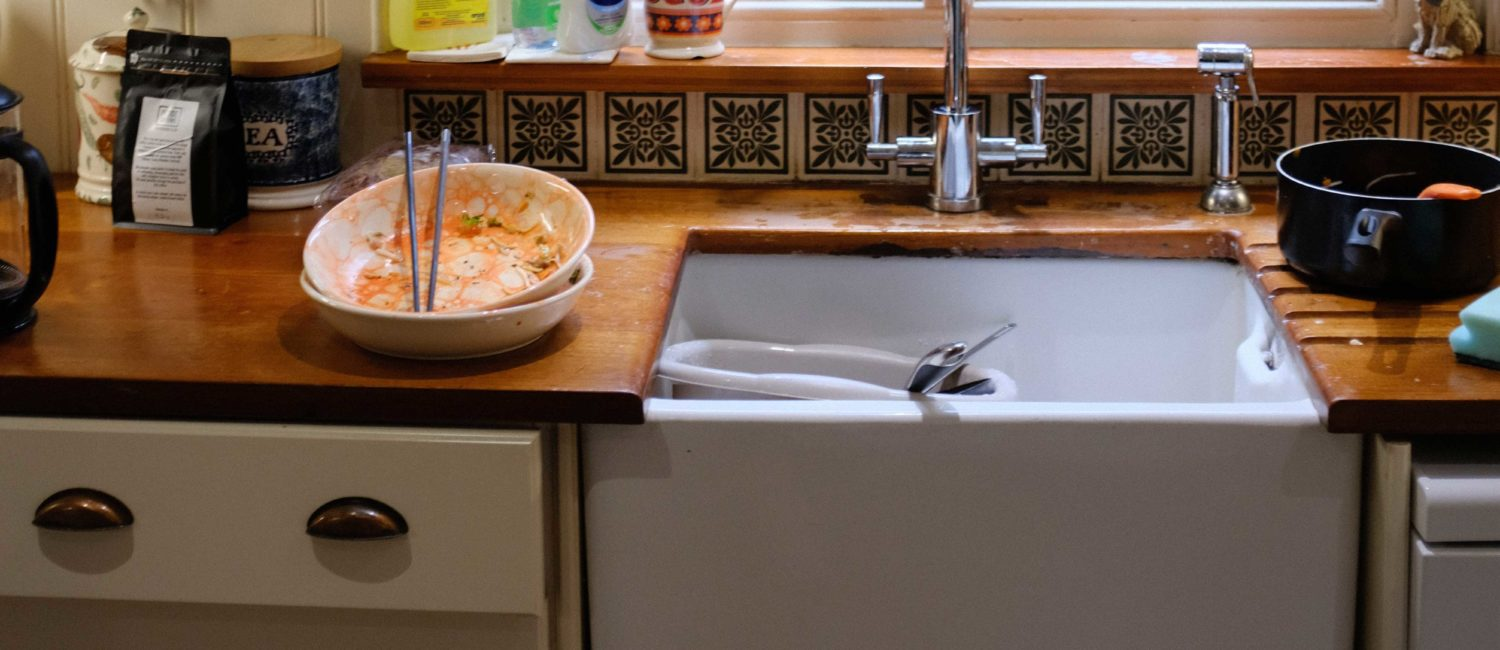 Used dishes by sink