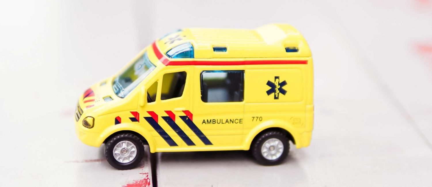 Toy ambulance on tabletop